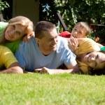 Cute family lying — Stock Photo