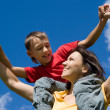 Mom with child at sky — Stock Photo