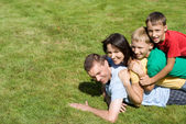 Family on grass — Foto de Stock