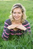 Nice woman on grass — Stock Photo