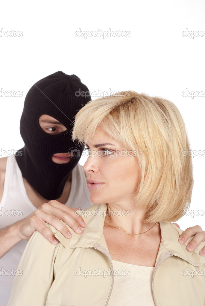 Robber in mask holds the woman on white — Stock Photo #6998068