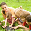 Family with laptop at nature — Stock Photo #7001344