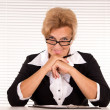 Old woman at office — Stockfoto