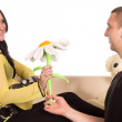 Pregnant woman on sofa with man — Stock Photo #7002860