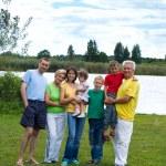 Family at lake — Stock Photo
