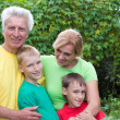 Grandparents with kids — Stock Photo