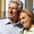 Old couple at palace - Stock Photo