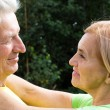 Aged couple at nature — Stock Photo #7008894