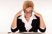 Elderly woman at office — Stock Photo