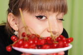 Girl and berries — Stock Photo