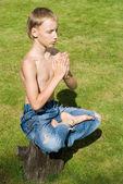 Young boy meditating — Stock Photo