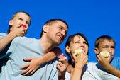 Family eating portrait — Stock Photo