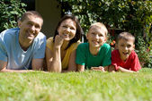 Cute family on a grass — Stock Photo