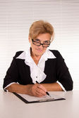 Woman at office — Stock Photo