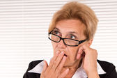 Smart old woman at office — Stock Photo