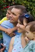 Happy family at nature — Stock Photo