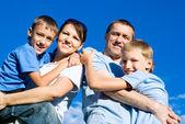 Happy family and sky — Stock Photo