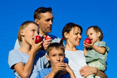 Family apples eating — Stock Photo