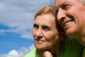Elderly couple at a sky — Stock Photo