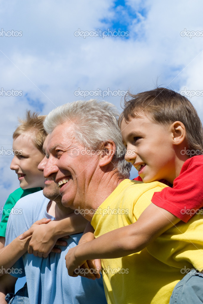 Portrait of a cute family on a sky background  Stock Photo #7007755