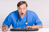 Doctor at table — Stock Photo
