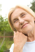 Old nice woman outside — Stock Photo