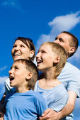 Family and the sky — Stock Photo