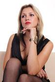 Woman at sofa — Stock Photo
