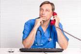 Doctor at office — Stock Photo