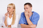 Doctor and nurse at table — Stock Photo