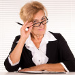 Old woman at office - Stockfoto