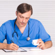 Doctor in office — Stock Photo #7185205