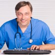 Doctor at table - Stock Photo