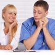 Doctor and nurse at table — Stock Photo #7186918