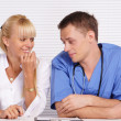 Doctor and nurse at table — Stock Photo #7186931