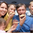 Family eating pizza — Stock Photo #7187245