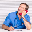 Doctor with telephone — Stock Photo #7187413