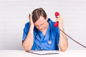 Doctor with telephone — Stock Photo