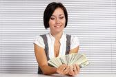 Nice girl and money — Stock Photo