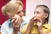 Granny and gramdson with pizza — Stock Photo