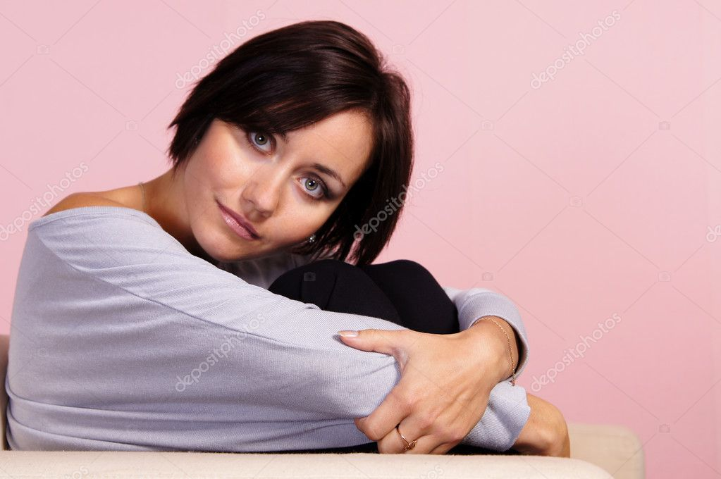Portrait of a cute young woman on a pink — Stock Photo #7185394