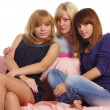 Girls at sofa — Stockfoto