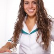 Cute nurse at table - Foto Stock
