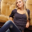 Cute blonde at sofa — Foto Stock