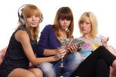 Three girls at sofa — Stock Photo