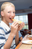 Young boy with pizza — Stock Photo