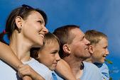 Family on sky — Stock Photo