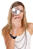 Girl with loupe — Stock Photo