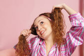 Adult girl on pink — Stock Photo