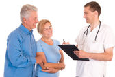 Doctor with patients — Stock Photo